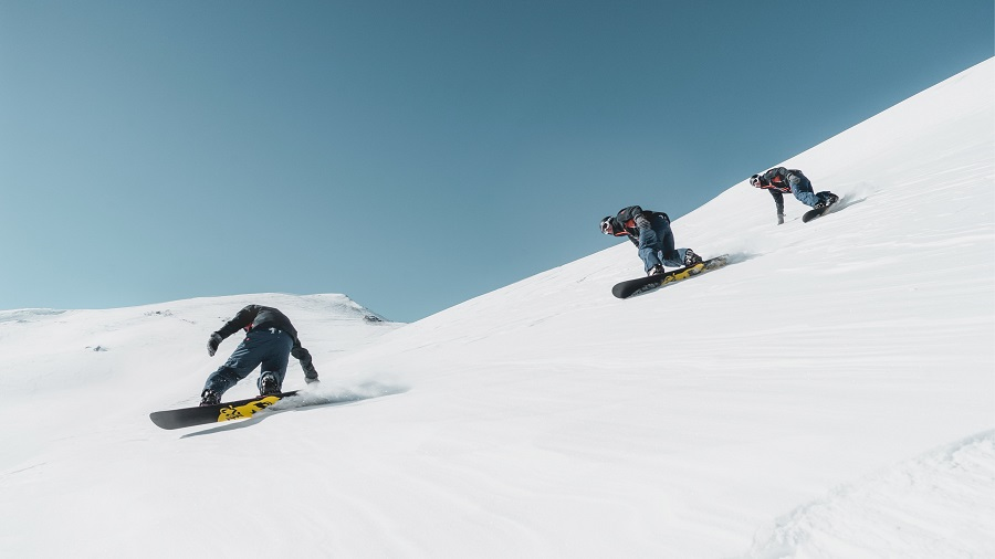Group snow boarding on a Working Holiday